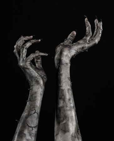 black hand of death, the walking dead, zombie theme, halloween theme, zombie hands, black background, isolated, hand of death, mummy hands, the hands of the devil, black nails, hands monster Stock Photo
