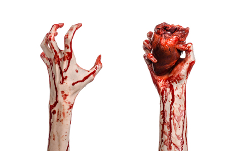 walking corpse: Blood and Halloween theme: terrible bloody hand hold torn bleeding human heart isolated on white background in studio