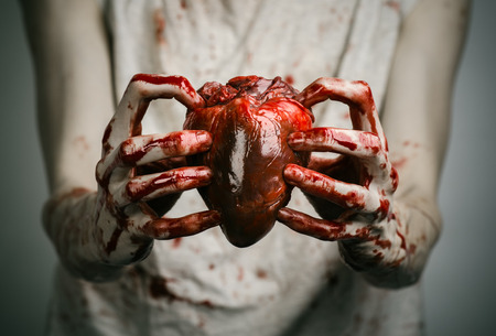 pain killer: Bloody Halloween theme: crazy killer keeps bloody hands torn bloody human heart and experiencing depression and pain