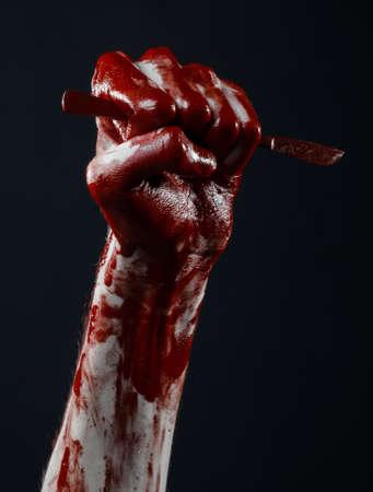maniac: Bloody hand with a scalpel, a nail, black background, zombie, demon, maniac