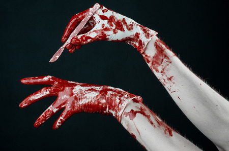 diabolic: Bloody hands in gloves with the scalpel, black background, isolated, doctor, killer, maniac