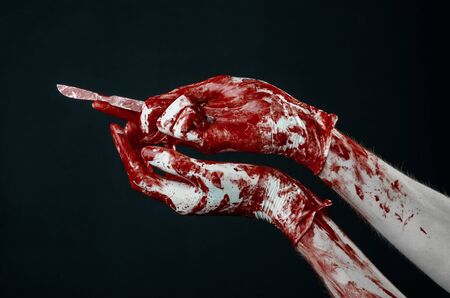 scalpels: Bloody hands in gloves with the scalpel, black background, isolated, doctor, killer, maniac