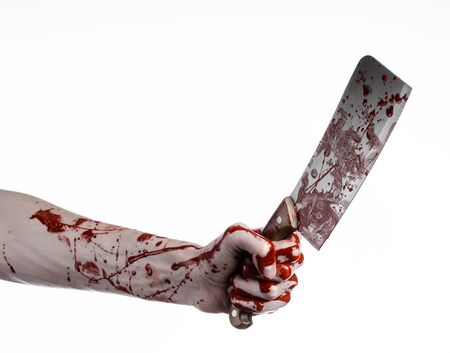 hatchet man: Bloody Halloween theme: bloody hand holding a large bloody kitchen knife on a white background isolated Stock Photo