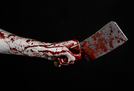 hatchet man: Bloody Halloween theme: bloody hand holding a large bloody kitchen knife on a black background isolated Stock Photo