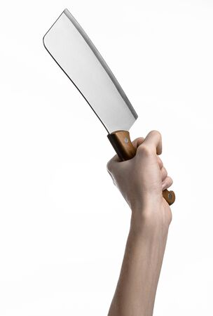 holding a knife: Hand holding a knife for meat, cleaver, chef holding a knife, a large knife, kitchen knife, kitchen theme, white background, isolated, butcher knife