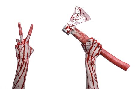 Bloody Halloween theme: bloody hand holding a bloody butchers ax isolated on white background in studio