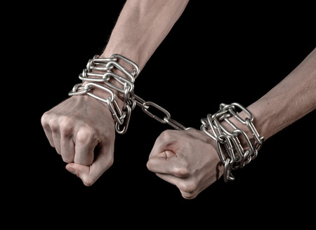 kidnapping: Hands tied chain, kidnapping, dependence, loneliness, social problem, halloween theme, killer, crazy, freedom black background