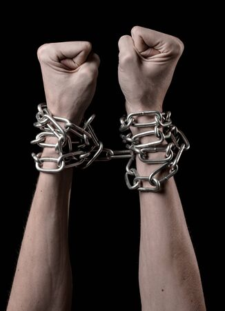 Hands tied chain, kidnapping, dependence, loneliness, social problem, halloween theme, killer, crazy, freedom black background