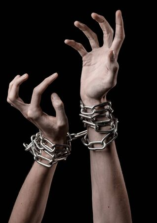 dependence: Hands tied chain, kidnapping, dependence, loneliness, social problem, halloween theme, killer, crazy, freedom black background