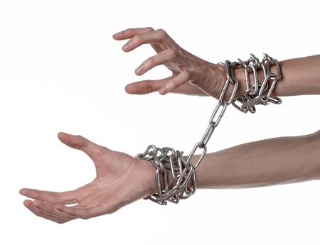 linked hands: Social theme: hands tied a metal chain on a white background