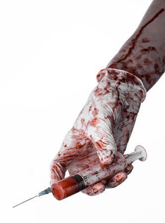 needle syringe infection: Bloody hand holding a syringe, bloody hands of the doctor, bloody syringe, large syringe, doctor killer, mad doctor, bloody gloves, bloody theme, white background, isolated