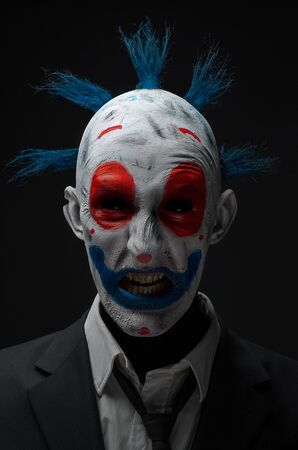 monsters house: Clown crazy zombies red blue in a jacket in studio Stock Photo