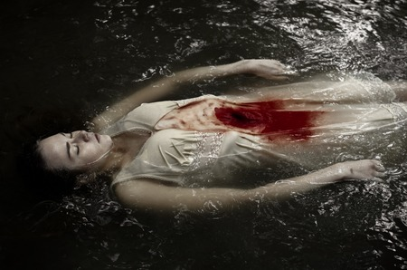 Dead girl floating in the river in dress, knife wound, blood, water, cold, dead woman