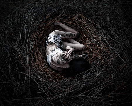 girl in the nest, corpse of the girl in the woods bloody
