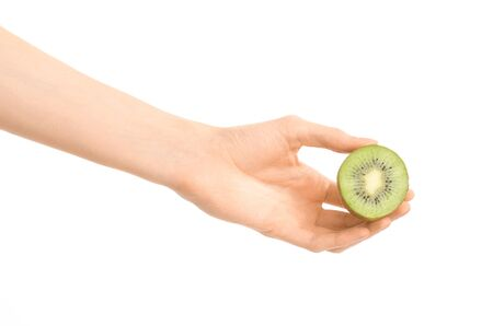 hairy arms: Healthy eating and diet Topic: Human hand holding a half kiwi isolated on a white background in the studio shot Stock Photo