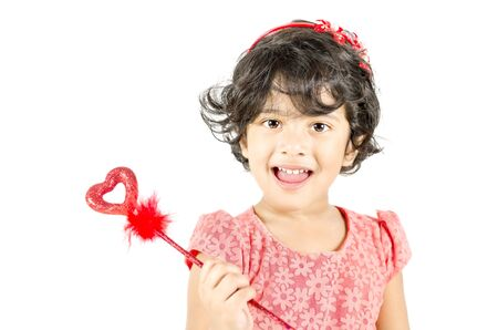 Little girl posing with love symbol isolated in white background