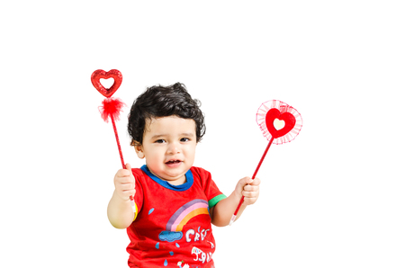 Little  cute boy posing with love symbol & smiling isolated in white background