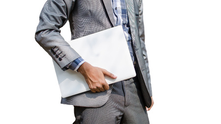 Business man holding white laptop isolated in white background