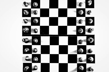 Black and white chessboard top view isolated in white background