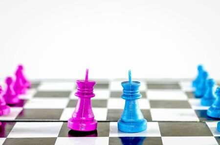 Purple and blue king  chasing in chessboard top view isolated in white background