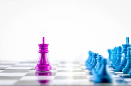 Purple king threatening blue team in a chessboard top view isolated in white background