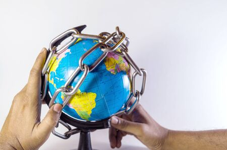 Conceptual chaining and protecting world globe holding hand idea isolated in white