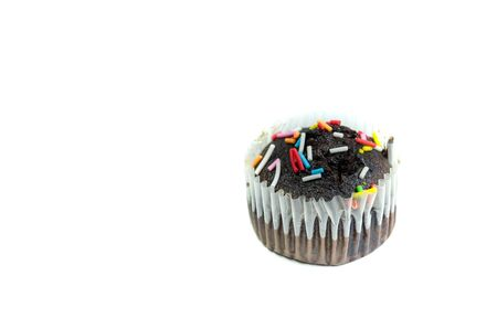 Delicious muffin cake with colorful toppings decoration isolated in white