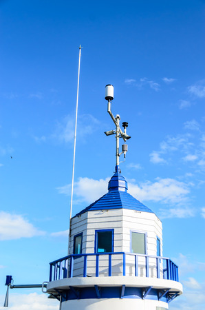 Blue warning tower with blue sky background photo