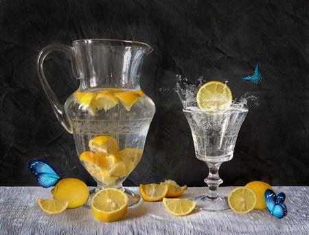 ewer: Still life with lemon splash and blue butterflies