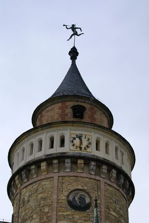 Photo of tower with weathercock and clock in Sychrov castle (czech republic)           photo