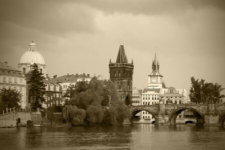 old styled sepia toned cityscape of historical center of Prague, Czech Republic photo
