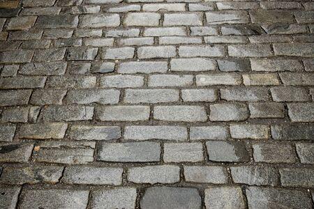 empedrado: textura de fondo de la antigua calle pavimentada con adoquines Foto de archivo