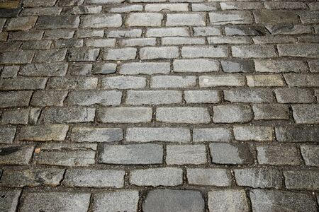 paved: textured background of ancient street paved with cobblestone