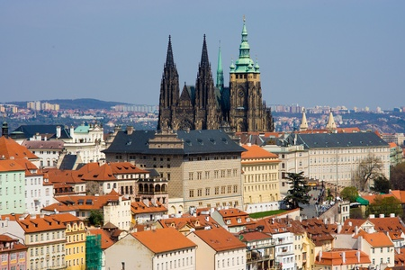 Old Prague panorama with sityscape of Hradcany, St  Vitus Cathedral and red roofs  czech republic photo