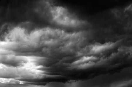 Cloudy stormy black and white dramatic sky background Stock Photo