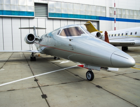 Luxury Business Private Jet plane at airfield toned in blue photo