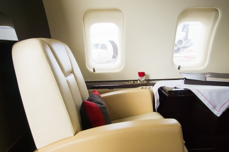 private jet: VIP Business Jet Interior with leather chair