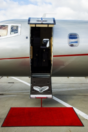 Luxury Business Private Jet plane open door at airfield Stock Photo