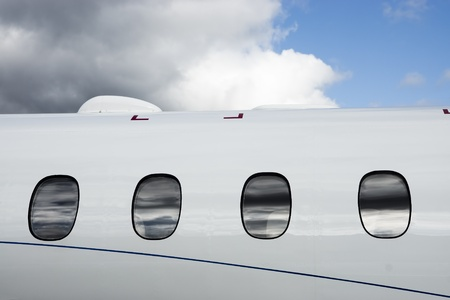 Luxury Business Private Jet plane windows raw photo