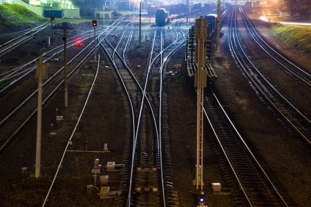 Cargo train platform station at night with container photo