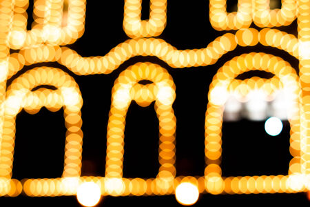 Defocused abstract yellow gold lights christmas arch background photo