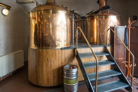 factory interior: Line of two traditional brewing vessels in brewery.