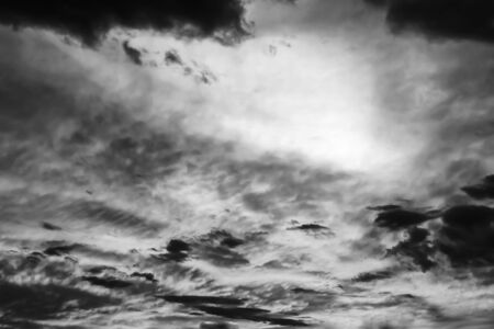 black white dramatic sky with cloud at sunset photo