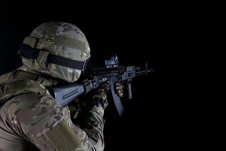 Dissolving SWAT soldier back view. swat soldier back view posing with a dissolving effect on a black background.