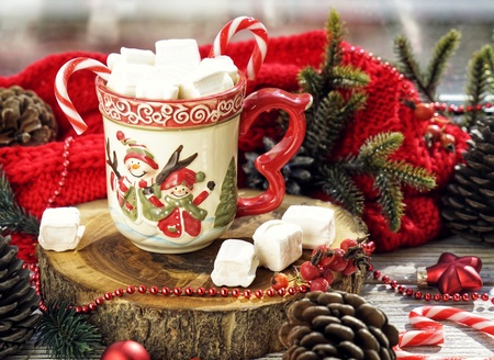 A cup of hot winter drink with marshmallow and cinnamon. New Year's background 2019. Stock Photo