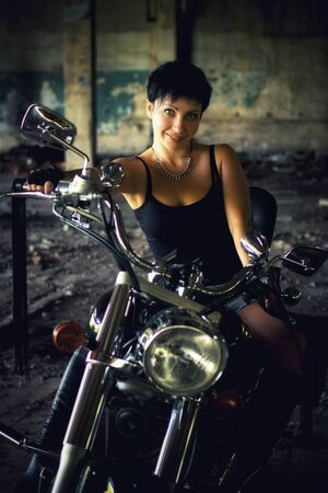 Strong independent , self-sufficient girl with male hobby on chopper motorcycle, international womens day concept.