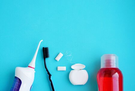 Oral hygiene, dental hygiene using dental tools, dental floss, irrigator, brush, chewing gum. The concept of health 스톡 콘텐츠
