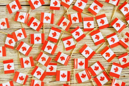 National day of Canada concept with flag on white wooden background top view