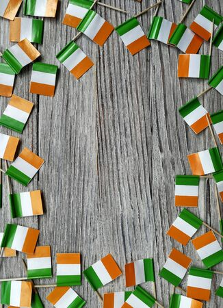 MARCH 17 Concept independence day of Ireland and Ireland national day.space for your text . mini flags on white wooden background. vertical Stockfoto