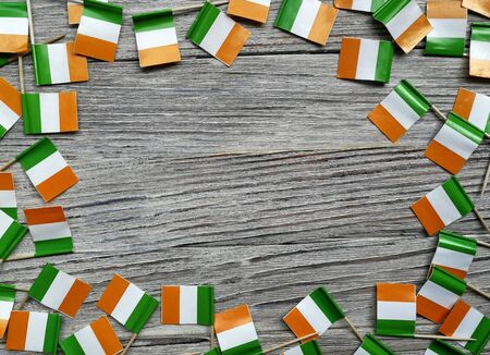 MARCH 17 Concept independence day of Ireland and Ireland national day.space for your text . mini flags on white wooden background, horizontal